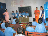 PVs assisting an English class in the primary school