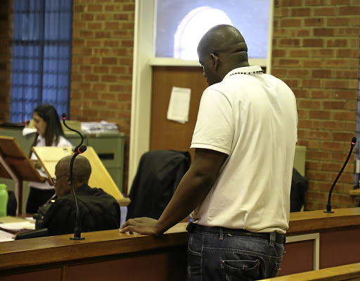 102703f4de A man accused of multiple rapes stands in the dock at the Protea  magistrate's court in