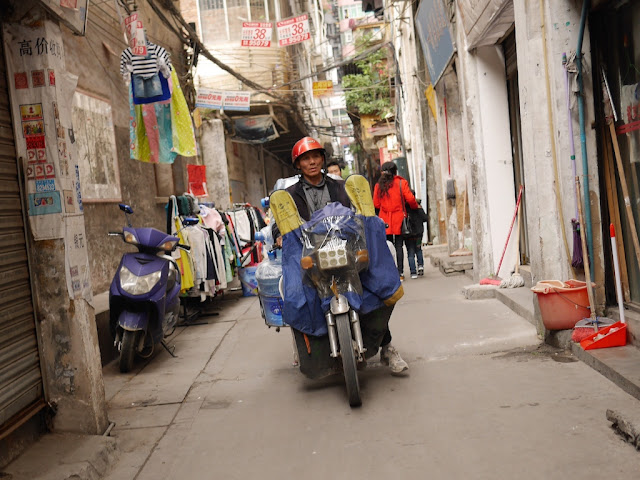 man on motorbike at Wuya Lane in Shaoguan, Guangdong