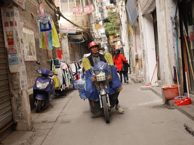 man on motorbike at Wuya Lane in Shaoguan, Guangdong