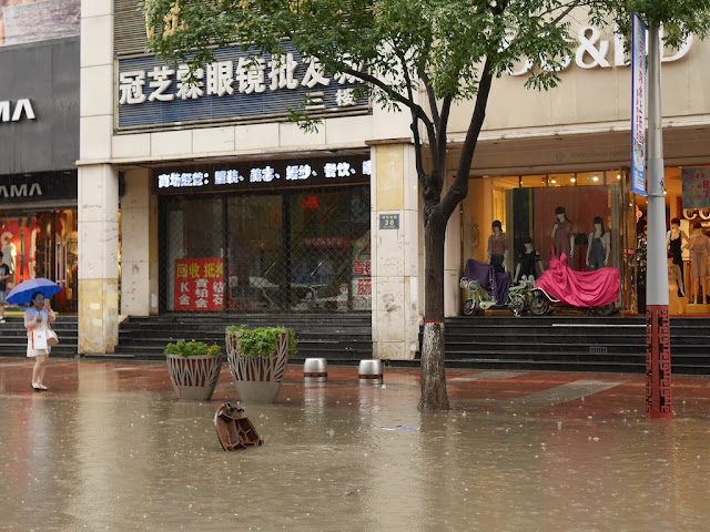 open sewer hole cover in a flooded street in Taiyuan, China