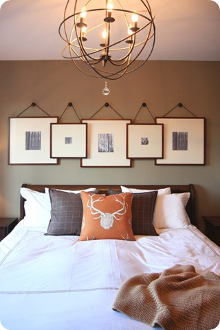 overlapping gallery frames above bed