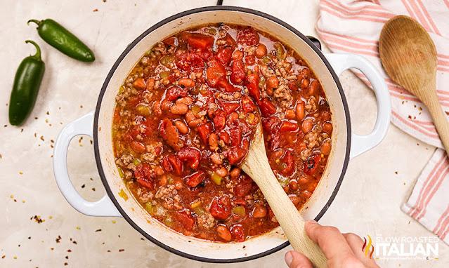 stirring homemade chili