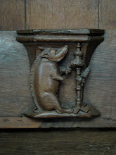 Photo: Boar wood carving detail. I think it's spinning, maybe?