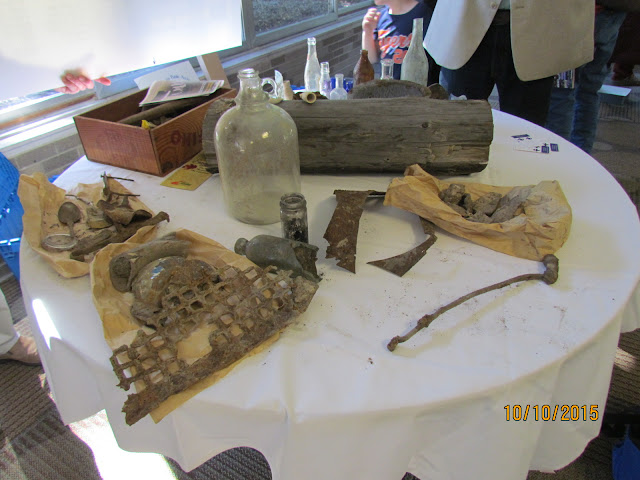 Front half of table holds artifacts from the cistern at the Emmendorfer home.