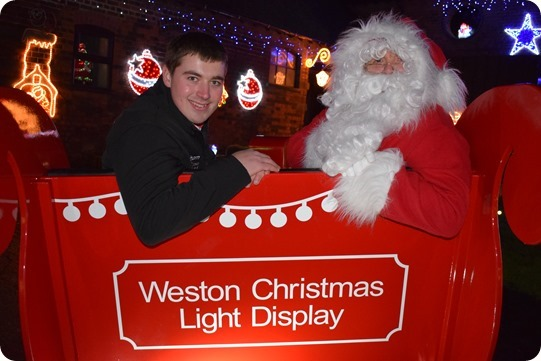 Graham Witter with Santa Claus in the life-size Santa  sleigh