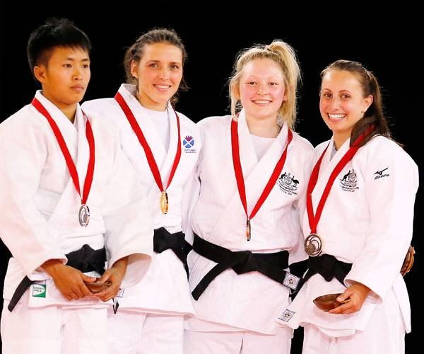 Winner Scotland's Kimberly Renicks , second from right, second placed Shushila Likmabam from India, left, and third placed Chloe Rayner from Australia and Amy Meyer from Australia pose with medals after their women -48kg Judo final bout at the Commonwealth Games 2014 in Glasgow, Scotland, Thursday July 24, 2014.