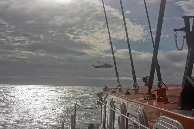 9 October 2011. Poole lifeboat and Portland Coastguard helicopter 106. Photo: Poole RNLI/Ade