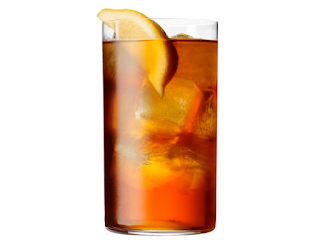 a stock photo glass of iced tea with a lemon slice in it.