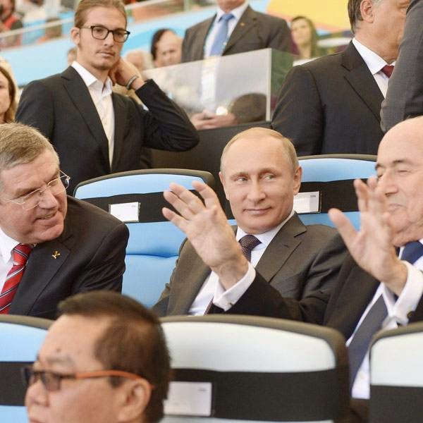 (From L) IOC chief Thomas Bach, Russia's President Vladimir Putin and FIFA President Joseph Blatter attend the 2014 FIFA World Cup final football match between Germany and Argentina at the Maracana Stadium in Rio de Janeiro on July 13, 2014.