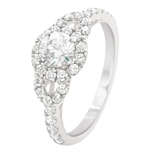 Beautiful ornate Engagement Ring with a Round Brilliant Diamond Center stone. More on - https://loye...