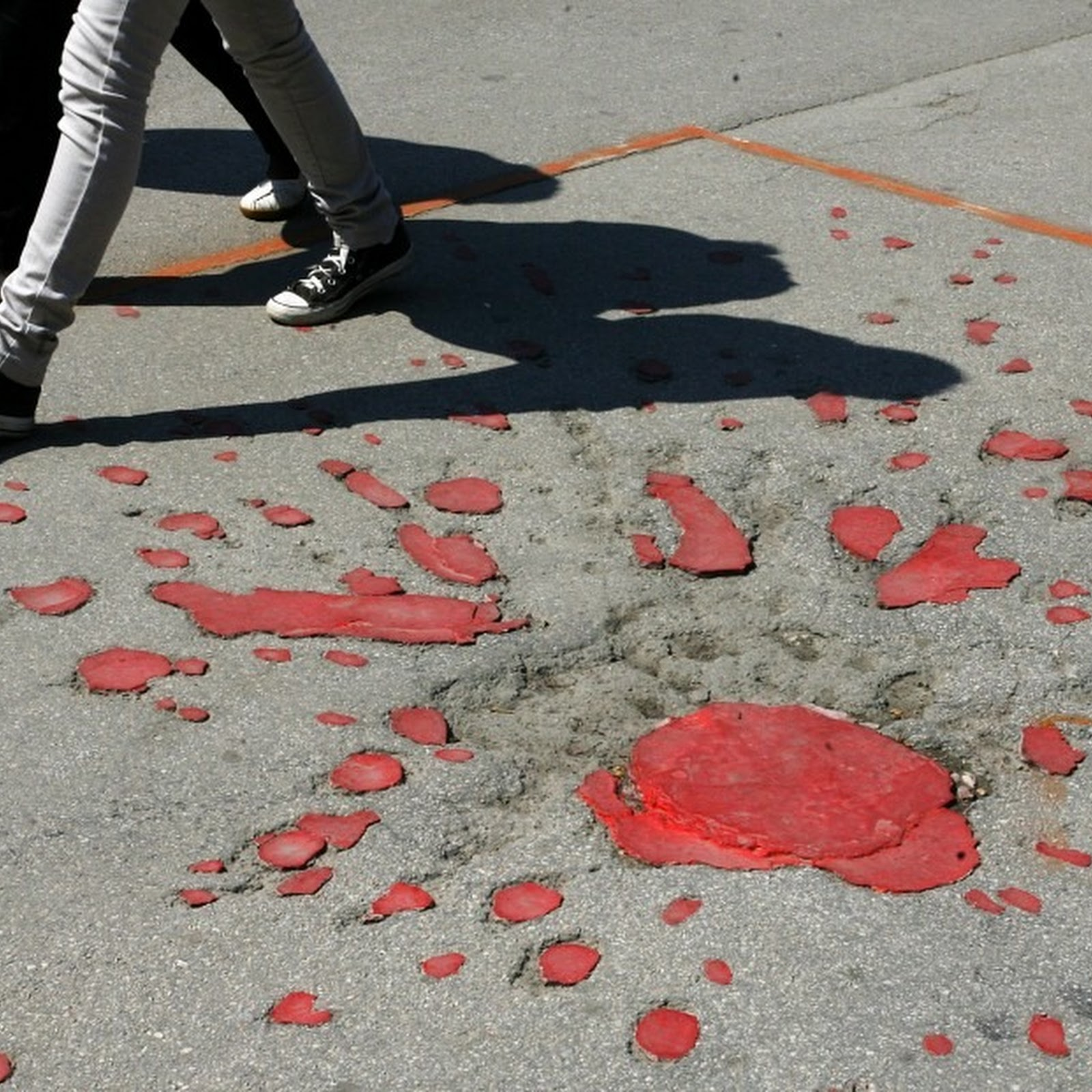 Sarajevo Roses: Mortar Scars Filled With Red Resin as War Memories