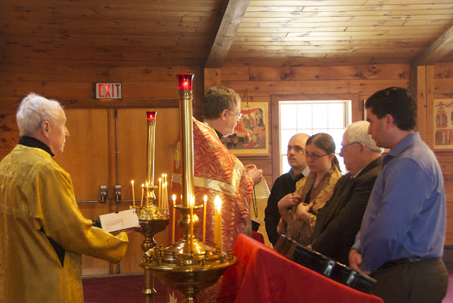 The catechumen receive a cross to wear, fashioned from boxwood in Georgia, a gift from our choir director.