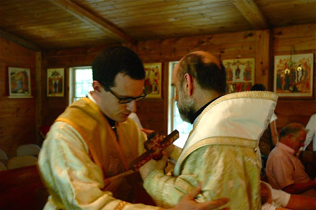 Vladyka embraces Subdeacon Nilus and congratulates him on his ordination.