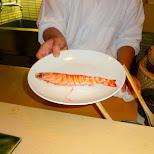 preparing a fresh giant shrimp for my lunch in Roppongi, Tokyo, Japan
