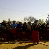 Bojale initiates singing in their subservient posture