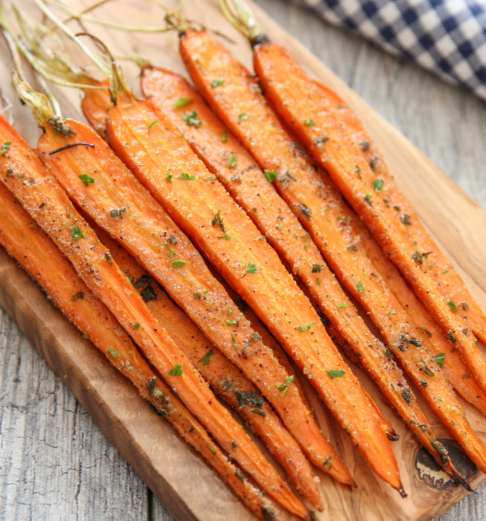 close-up of ranch roasted carrots on a cutting board