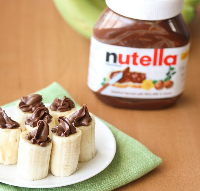 photo of nutella stuffed bananas with a jar of nutella in the background
