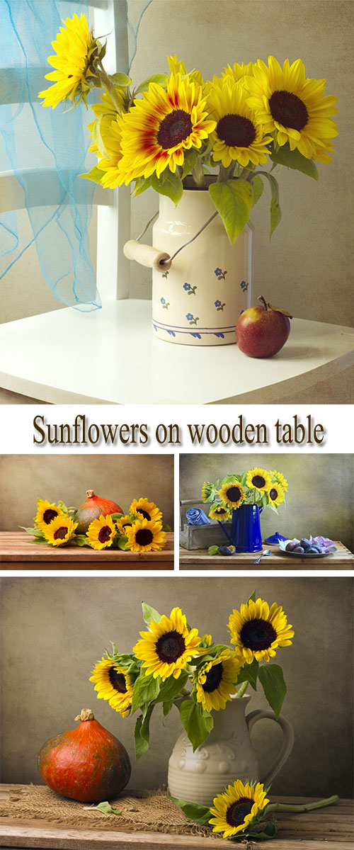 Stock Photo: Sunflowers on wooden table
