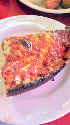 One of my 3 best Chicago pizza picks: Pequod's Pizza, which is known for how when they are laying down the cheese they overlap it on the edges and then over all the crust in the, which then melts over for this signature caramelized edge.