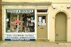 obvious hardware shop frontage newly painted in cream