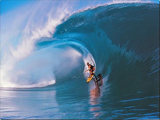 Surfing in Teahupoo, Tahiti.jpg