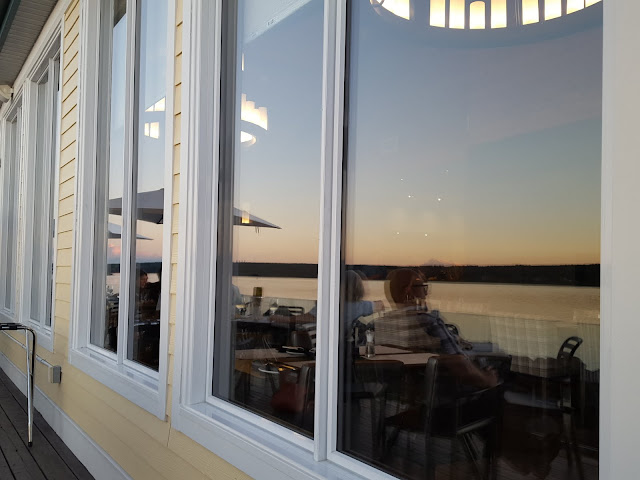 The sunset on the river, reflected in the windows on the deck. Where to Stay - and Eat - in Miramichi, New Brunswick: the Rodd Hotel and Resort, and their fantastic 1809 Restaurant