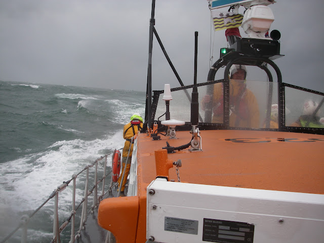 23 September 2012 - rough weather ALB training exercise in Poole Bay.  Second Mechanic Rich Skerman at the helm. Photo credit: Poole RNLI/Dave Riley.