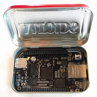 The BeagleBone Black single-board computer inside an Altoids mint tin.