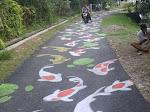 Lukisan Ikan Di Sepanjang Jalan Menjadi Tempat Swafoto Yang Ikonik