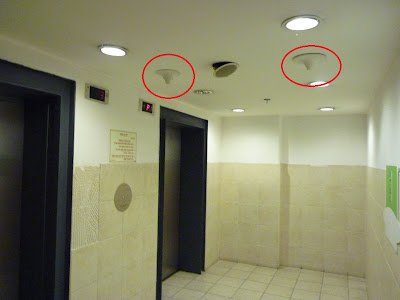 Micro-cell antenna in an elevator lobby room