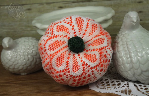 Lace doilie wrapped pumpkin