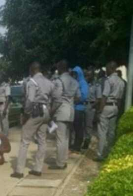 Customs officers punish two men for impersonating them in Abuja (Photos)