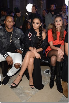 NEW YORK, NY - FEBRUARY 13:  (L-R) Victor Cruz, Shay Mitchell, and Taylor Hill attend the Front Row for the Philipp Plein Fall/Winter 2017/2018 Women's And Men's Fashion Show at The New York Public Library on February 13, 2017 in New York City.  (Photo by Andrew Toth/Getty Images for Philip Plein)