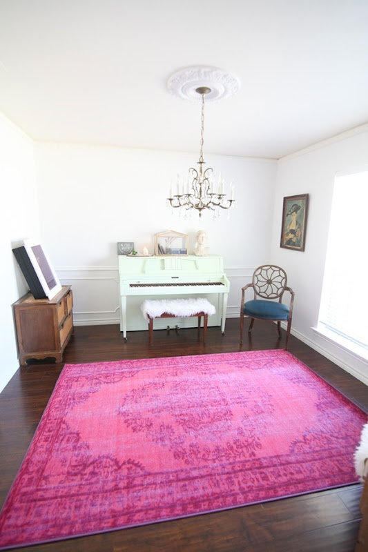 This-room-is-filled-with-my-favorite-colors-mit-white-and-pink-I-love-that-painted-piano-and-pin-rug.-4-of-9