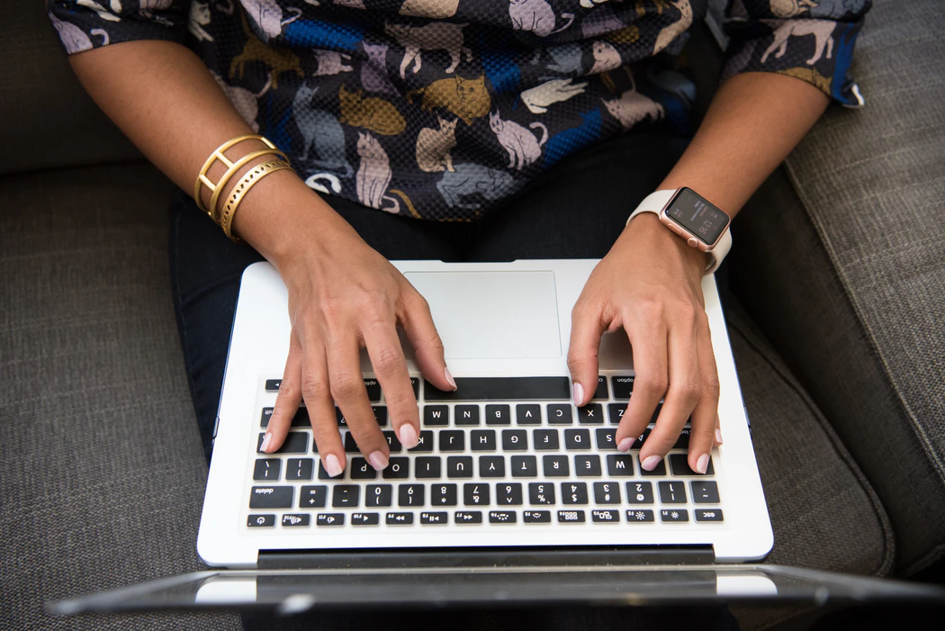 woman's hand on laptop