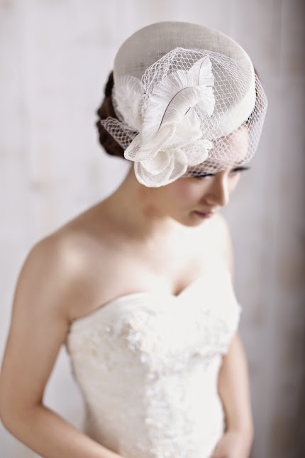 e4672458 Traditional hand-made hat techniques sewn hat. Sinamay hat fabric caused by  the use of. Coupled with Birdcage Veil Coolie flowers and ostrich * Handmade  ...