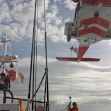 9 October 2011. Winchman from helicopter 106 being winched aboard Poole lifeboat. Photo: Poole RNLI/Ade