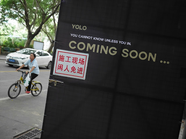 "sign with text ""YOLO, You cannot know unless you in. Coming soon . . ."""