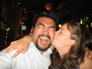 My coworker Shannon is giving me a kiss. After working in the trenches with her, I will miss our bantering. Photo taken on July 13, 2007.