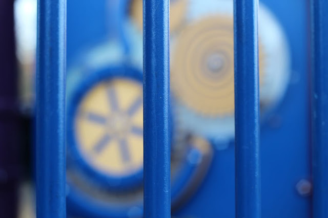 playground toys: blue bars, yellow gears