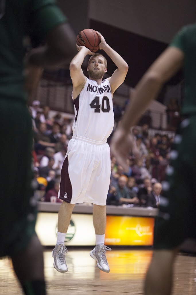 Hometown favorite Mathias Ward takes a shot from the perimeter during the second half of Saturday's 62-55 victory over Portland State.  Dahlberg Arena in Missoula, Mont., January 5th, 2013.