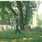 George weedeats as helper pickes up sticks