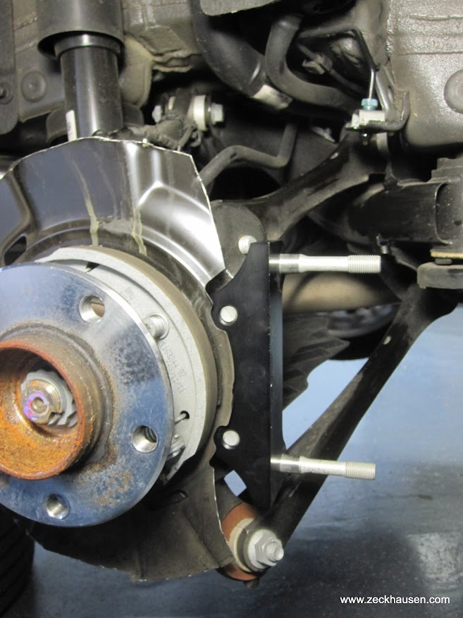 Bmw 328i Brake Pads ... is installed using the stock brake caliper bolts, torqued to 55 lb-ft