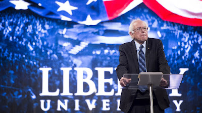 Sanders defends to supporters his speech at a Christian university