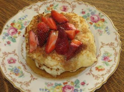 "Sunshine Ricotta Pancakes with Strawberries""After a long winter these pancakes are a..."
