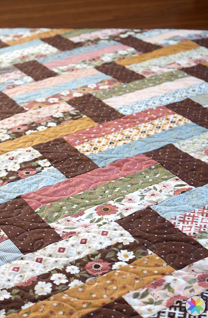 Fast Track quilt pattern using Folktale fabric from Moda fabrics - an awesome jelly roll quilt pattern but you could also use fat quarters