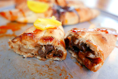 Portland Dumpling Week 2016 from Sizzle Pie: Meat pizza dumplings collaboration with Kim Jong Grillin' of Jjajang smoked pork, Sizzle Pie cheese blend, scallions, fermented black bean paste with pickled yellow daikon and gochujang sauce.
