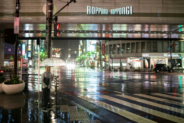 At the world-famous crossing in Shibuya, Tokyo, where thousands normally jostle every few minutes as the lights change, just a few hardy souls braved the horizontal rain and powerful gusts of Typhoon Trami, 30 September 2018. Photo: Martin Bureau / AFP