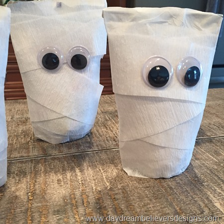 Easy to DIY Mummy juice pouches. So cute for Halloween lunch!